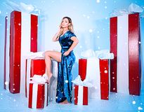 Beauty fashion woman Christmas background new year tree. Vogue style sexy girl. Gorgeous female in luxury fur at Xmas. Gorgeous female in luxury fur at Xmas Stock Photography