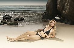 Gorgeous female model in bikini on beach Royalty Free Stock Photos