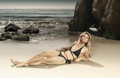 Gorgeous female model in bikini on beach. Horizontal full body portrait of beautiful blond model in bikini on beach Royalty Free Stock Photos