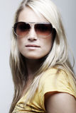 Gorgeous female model posing in sunglasses Stock Image