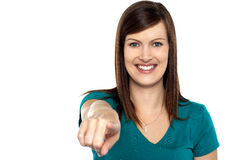 Gorgeous female pointing towards the camera Royalty Free Stock Images