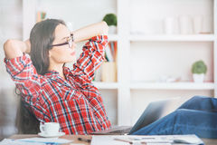 Gorgeous female relaxing in office Royalty Free Stock Images