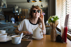Gorgeous female smiling charmingly while spending her recreation in the restaurant Stock Photo