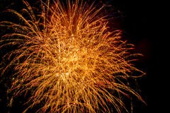 Gorgeous fireworks display on dark background. With copyspace Royalty Free Stock Images