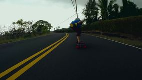 Gorgeous 4k first person pov on extreme sport male skater skating downhill fast long road performing stunts on longboard stock footage