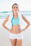 Gorgeous fit blonde in sportswear holding towel Royalty Free Stock Photo
