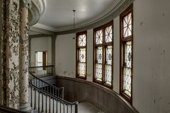 Gorgeous Floor to Ceiling Windows - Abandoned Courthouse. Inside a derelict and abandoned courthouse in Massachusetts looking towards some floor to ceiling Royalty Free Stock Photo