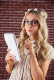 Gorgeous focused blonde hipster taking notes Stock Photos