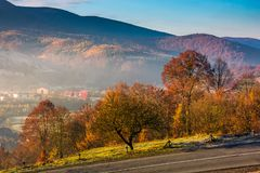 Gorgeous foggy morning in autumn countryside. Lovely rural scenery in mountainous area Stock Photos
