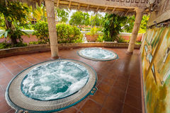 Gorgeous fragment of view of outdoor spa with hydro massage Jacuzzi. Holguin Province, Playa Pesquero hotel, Cuba, Sep. 4, 2016, mesmerizing gorgeous fragment of Royalty Free Stock Image
