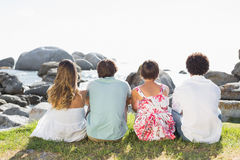 Gorgeous friends looking out to sea Stock Photo