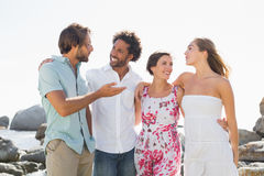 Gorgeous friends smiling at each other Stock Photo