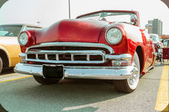 Gorgeous front side view of red old classic vintage retro car Royalty Free Stock Photography