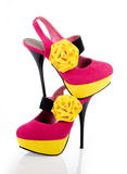 Gorgeous fuchsia shoes with a yellow flower. Gorgeous fuchsia women's shoes with a yellow flower on a white background stock photography