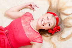 Gorgeous funny young blond pinup woman happy smiling & looking at camera nicely over white background Royalty Free Stock Photo