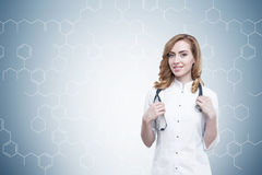 Gorgeous ginger doctor and atom grid Stock Photography
