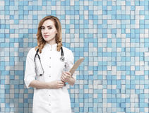 Gorgeous ginger doctor and blue tile wall Stock Images