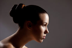 Gorgeous girl. Beautiful girl with stylish hair in low key setting Royalty Free Stock Image