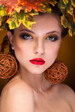 Gorgeous girl with autumn make up and leaves Stock Photo