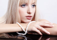 Gorgeous girl with beads Royalty Free Stock Image