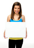 Gorgeous girl with blank presentation board Stock Images