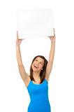 Gorgeous girl with blank presentation board Royalty Free Stock Image