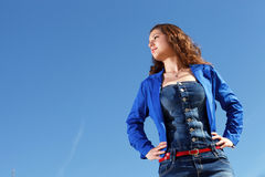 Gorgeous girl with blue sky background Royalty Free Stock Image