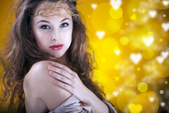 Gorgeous girl with a branch in hair, proffesional make up, studi Stock Image