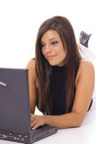 Gorgeous girl checking emails on laptop vertical Royalty Free Stock Image
