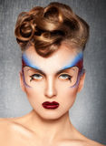 Gorgeous girl with creative multicolor make up Stock Images