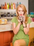 Gorgeous girl drinking coffee Stock Photography