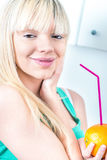 Gorgeous girl drinking an orange from a straw Royalty Free Stock Photos