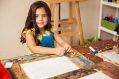 Gorgeous girl enjoying art class Stock Images
