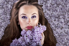 Gorgeous girl with flowers in hair, proffesional make up Stock Photo