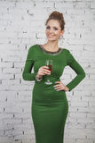 Gorgeous girl in green dress with champagne Stock Photos