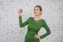 Gorgeous girl in green dress with champagne Royalty Free Stock Images