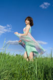 Gorgeous girl  on a green meadow Royalty Free Stock Photography
