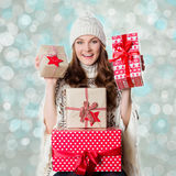 Gorgeous girl holding beautifuly wrapped presents, xmas concept. With bokeh background Royalty Free Stock Photo