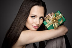 Gorgeous girl holding a gift in her hands Royalty Free Stock Photos