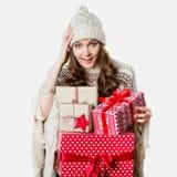 Gorgeous girl holding xmas presents, stunned Royalty Free Stock Photos