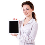 Gorgeous girl holdint a tablet pc in her hands isolated on white Royalty Free Stock Image