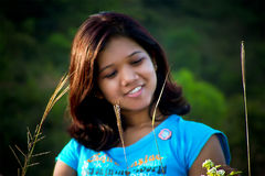 Gorgeous Girl looking at small plants Royalty Free Stock Photography
