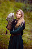 gorgeous girl in medieval dress with an owl on her arm Stock Photography