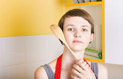 Copyspace portrait of a cooking girl with spoon Royalty Free Stock Photos