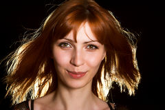 Gorgeous girl in red-haired wig Royalty Free Stock Photography
