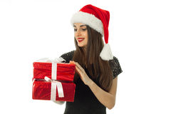 Gorgeous girl in santa hat with red gift box Royalty Free Stock Photo