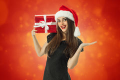 Gorgeous Girl in santa hat smiling Royalty Free Stock Photos