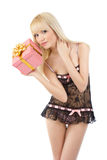 Gorgeous girl in sexy pink lingerie with gift box Stock Image