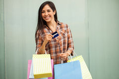 Gorgeous girl shopping with her credit card Royalty Free Stock Images