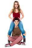Gorgeous girl sitting on her boyfriend's shoulder Stock Image